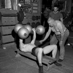GPHR 45/7702: Bernard H.B. Lange, CSC, in gym with students weightlifting.