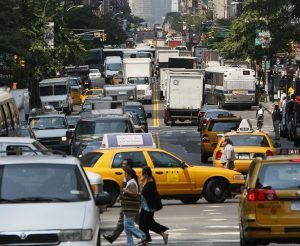 Cars, taxis and trucks sit in traffic in midtown Manhattan 15 August 2007 during the morning rush hour. The federal government has given New York City Mayor Michael Bloomberg a postdated check of 354 million USD for his plan to ease city traffic through new tolls if he can win the approval of local lawmakers.The plan if enacted, calls for charging 8 USD to drive a car into Manhattan south of 86th street on weekdays between 6 a.m. and 6 p.m (1800 GMT) and trucks would pay 21 USD. It would be the first city in the United States to have such a toll. AFP PHOTO TIMOTHY A. CLARY (Photo credit should read TIMOTHY A. CLARY/AFP/Getty Images)