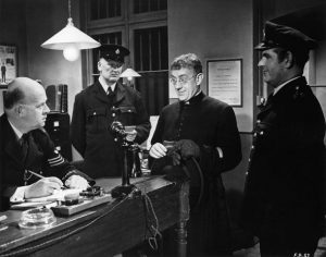"""Still from the movie """"Father Brown the Detective,"""" based on the stories by G.K. Chesterton and starring Alec Guinness as the titular character."""